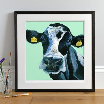 Lifestyle photo of a Framed print of a British White Cow