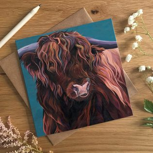 Hereford Calf playing in a field of flowers card