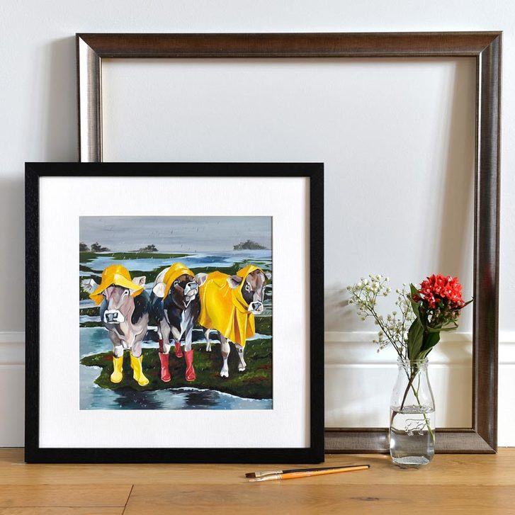 Fun rainy day art print of three cows in wellies and coats