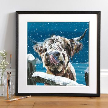 Lifestyle photo of a Framed Snowy Cow print by Lauren's Cows