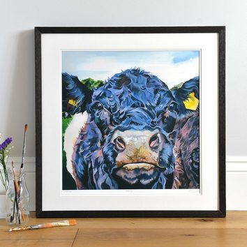 Lifestyle photo of a Framed Morag limited print by Lauren's Cows