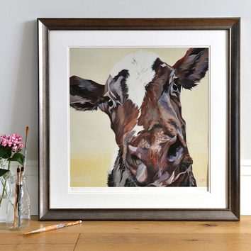 Lifestyle photo of a Framed Ruby limited edition print by Lauren's Cows