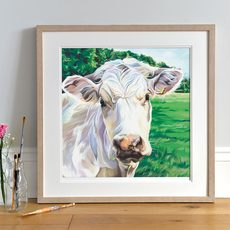 Lifestyle photo of a Framed Light 'Ivory' print by Lauren's Cows