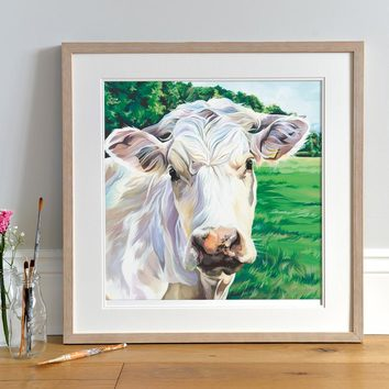 Lifestyle photo of a Framed 'Ivory' print by Lauren's Cows