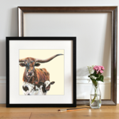 Lifestyle photo of a Framed Texas Longhorn Cow and Calf by Lauren's Cows