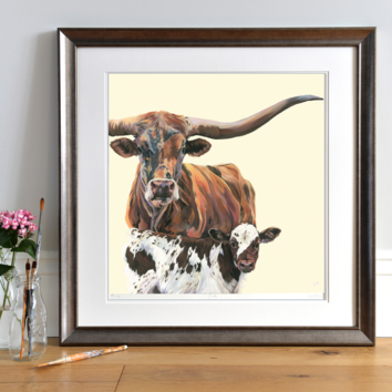 Lifestyle photo of a framed open edition print of Texas Longhorns