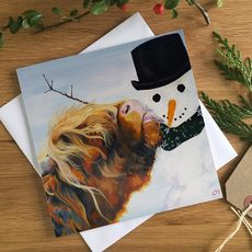 Highland Cow licking a Snowman Christmas Cards from Lauren's Cows