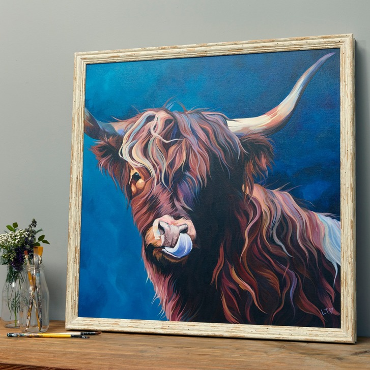 Framed Canvas Painting of a cheeky Highland Cow