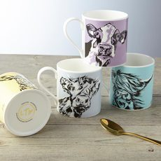 A collection of four Cow mugs for the Country Kitchen