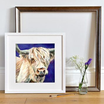 Lifestyle photo of a Framed White Highland Cow