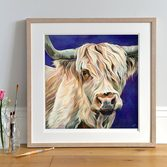 Lifestyle photo of a Framed Highland Cow art print by Lauren's Cows